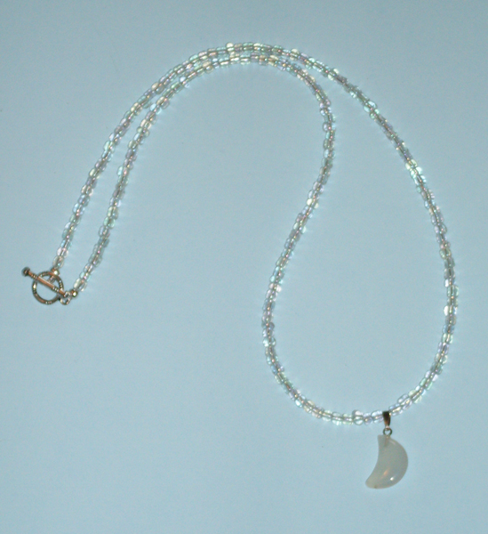 necklace in clear glass with milky white crescent moon