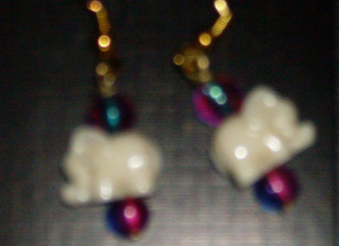 earrings with white elephants and multicolored beads