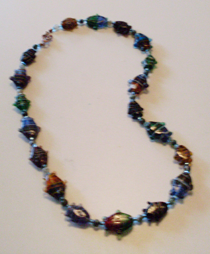 necklace with brightly colored lampwork glass fish