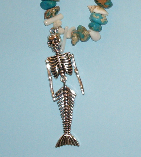 mermaid skeleton pendant on necklace