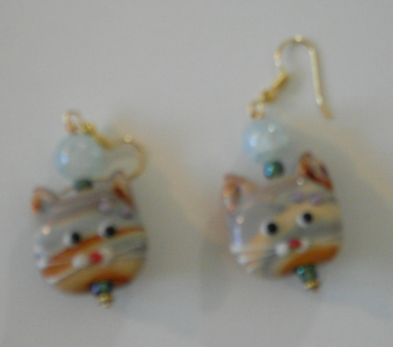 earrings with taffy-swirled glass cat faces